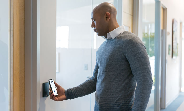 Man Opening Door with Mobile Phone